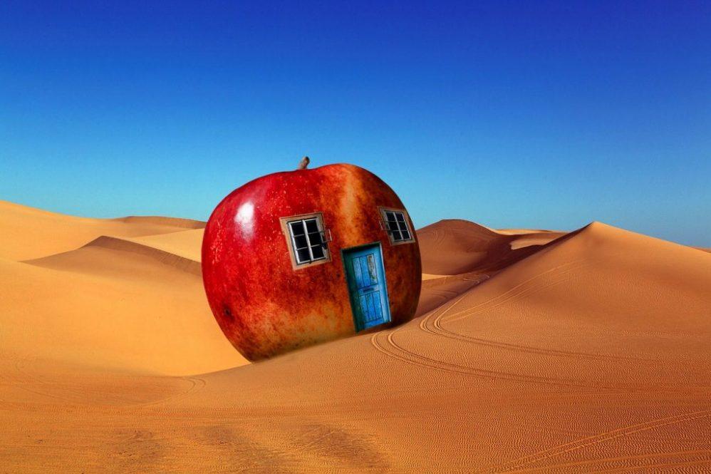 Shifting sand, apple house in the desert