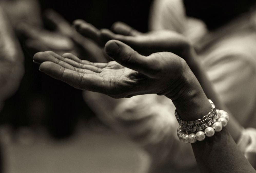 hands surrender praise pray