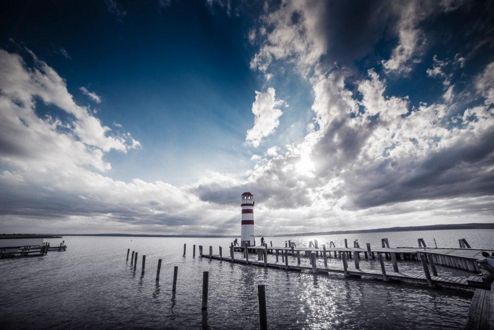 lighthouse on stormy pier clouds vengence is mine says the Lord
