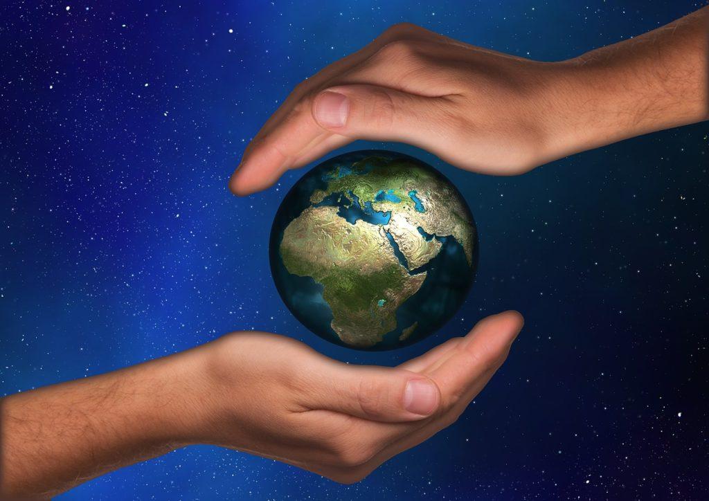 world glove hand earth